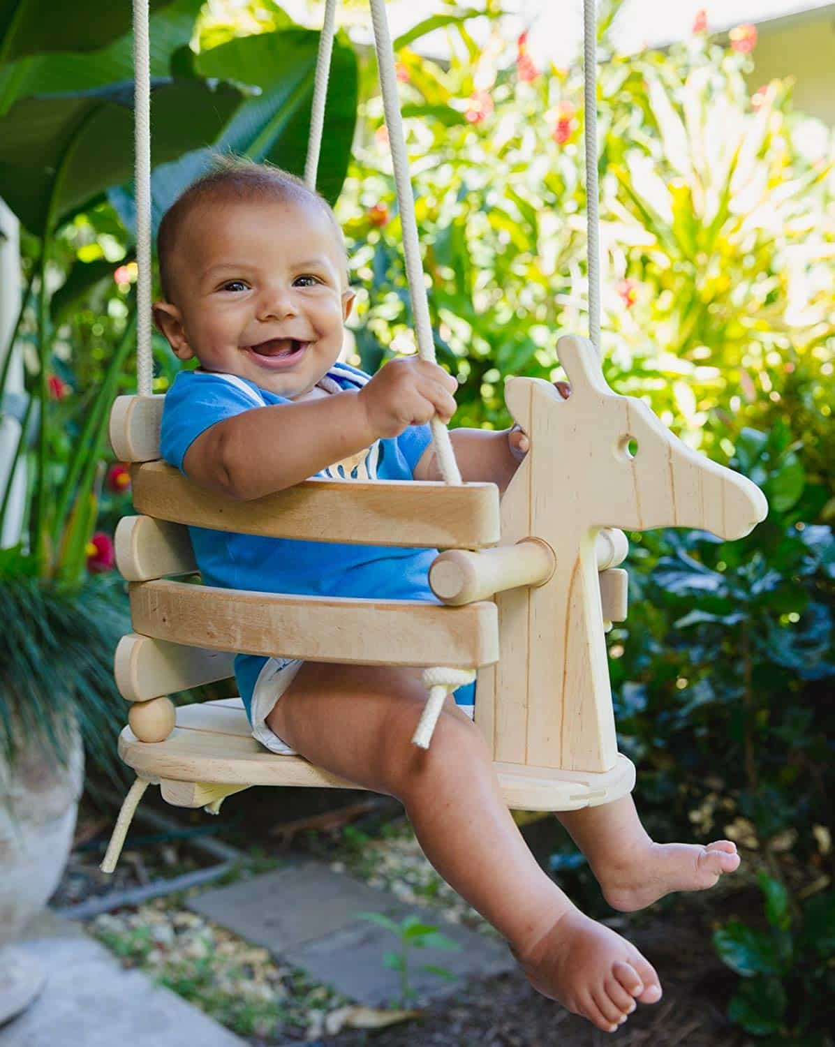 8.      Ecotribe wooden horse toddler swing